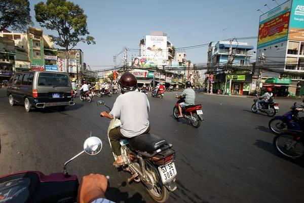 Wall Art - Photograph - Vietnam, Ho Chi Minh City, Rush Hour by Pascal Deloche