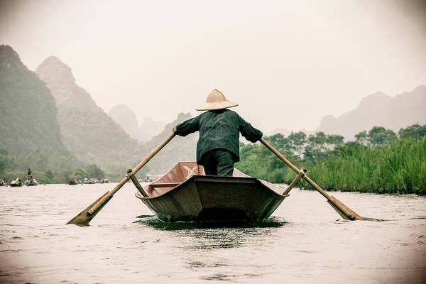 Oar Photograph - Vietnamese Rower In Boat by By Jérémie Lusseau