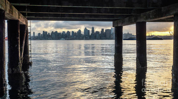 Photograph - View Of Downtown Seattle At Sunset From Under A Pier by PorqueNo Studios