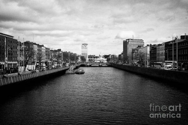 Wall Art - Photograph - view of the river liffey and dublin city centre skyline from the halfpenny bridge Dublin Republic of by Joe Fox