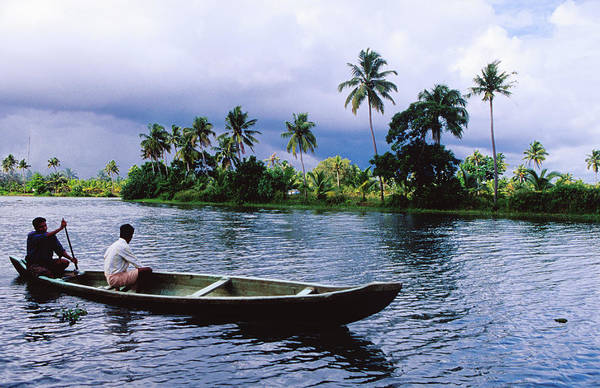Canoe Photograph - Villagers Travelling By Canoe On by Richard I'anson