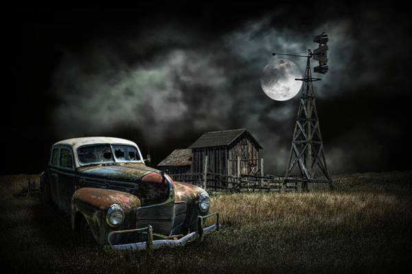 Photograph - Vintage Automobile And Wooden Barn With Windmill By Moon Light by Randall Nyhof