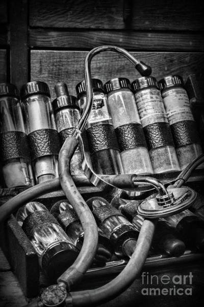 Wall Art - Photograph - Vintage Doctors Stethoscope And Kit Black And White by Paul Ward