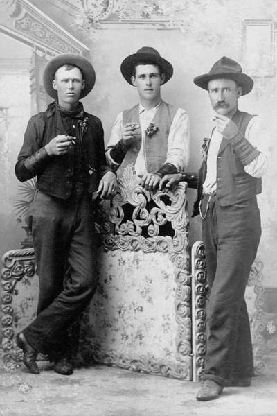 Old People Photograph - Vintage Image Of Cowboys Drinking And by Thinkstock Images