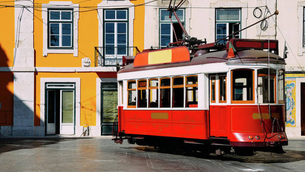 Photograph - Vintage Red And White Tram On The Street Of Lisbon, Portugal by Alexandre Rotenberg