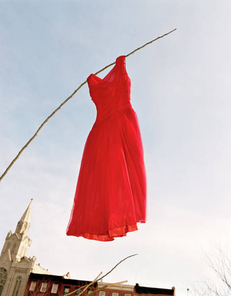 Red Dress Photograph - Vintage Red Dress Hanging From Stick In by Micaela Rossato
