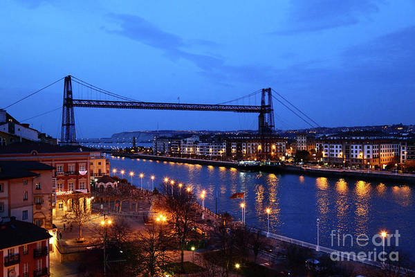 Photograph - Vizcaya Transporter Bridge Near Bilbao At Blue Hour by James Brunker