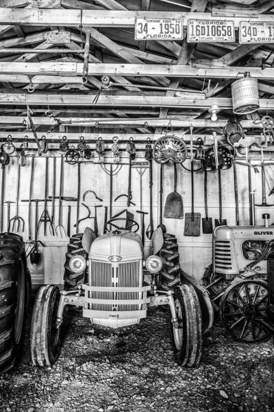 John Oliver Cabin Photograph - Waiting In The Garage Tools And Tractors In Black And White by Debra and Dave Vanderlaan