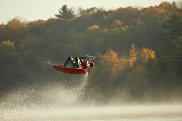 Waterskiing Photograph - Wakeboarder Jumping In Lake by Lwa