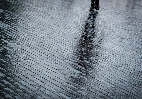 Wall Art - Photograph - Walking Shadow Of An Unrecognised Person Walking On Wet Streets  by Michalakis Ppalis