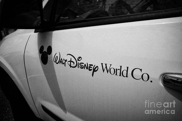 Wall Art - Photograph - Walt Disney World Co Company Name And Logo On A Vehicle Florida United States Of America by Joe Fox