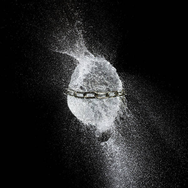 Wall Art - Photograph - Water Explosion Of A Balloon Tightened By A Steel Chain by Gualtiero Boffi