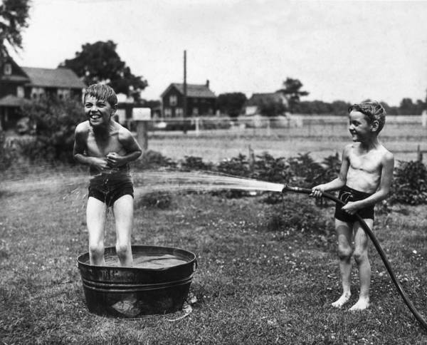 Playful Photograph - Water Games by Archive Photos