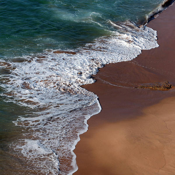 Sagre Wall Art - Photograph - Waves On A Red Sand Beach by Julio Lopez Saguar