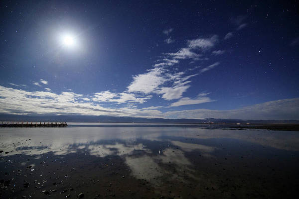 Photograph - Waxing Moon Shining Above The Salt Lake by Jeff Dai