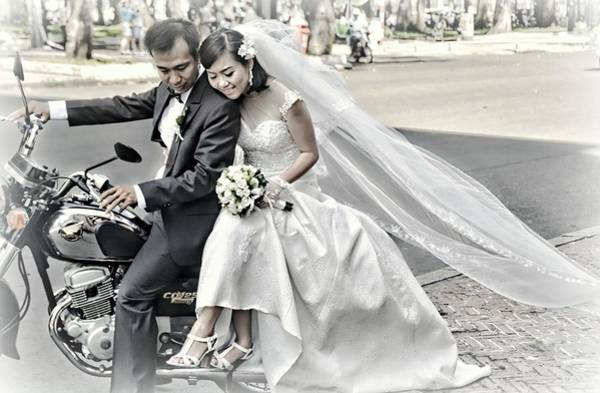 Wall Art - Photograph - Wedding Couple On A Motorcycle by Toni Abdnour