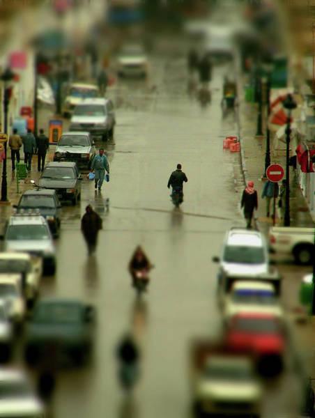 Tunisia Wall Art - Photograph - Wet Street And People On Road In El Jem by Nigel Breadman Www.breadmannphotographic.com