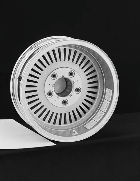 1976 Photograph - Wheel Rim Against Black Background by Tom Kelley Archive