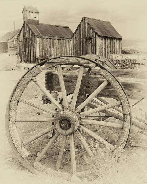 Photograph - Wheels And Spokes by James Eddy