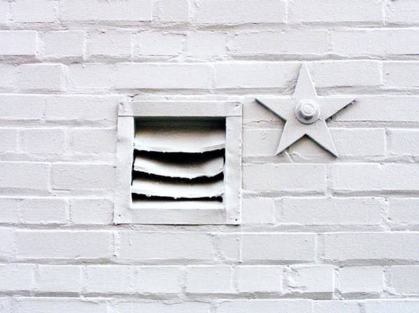 Brick Wall Photograph - White Brick Wall With Vent And Star by Linus Gelber / Alert The Medium