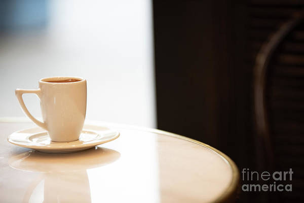 Photograph - White Coffee Cup On A Marble Table Inside Of A Cafe. by Joaquin Corbalan