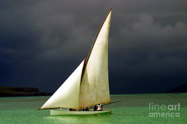 Water Transport Photograph - White Sailed Pirogue On The Ocean by Paul Banton