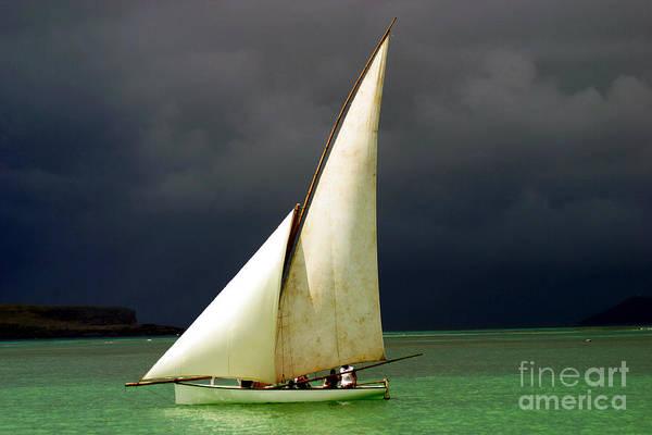 Mast Wall Art - Photograph - White Sailed Pirogue On The Ocean by Paul Banton