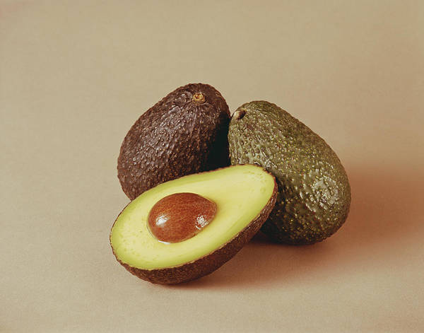 1981 Photograph - Whole And Half Avocado On Beige by Tom Kelley Archive