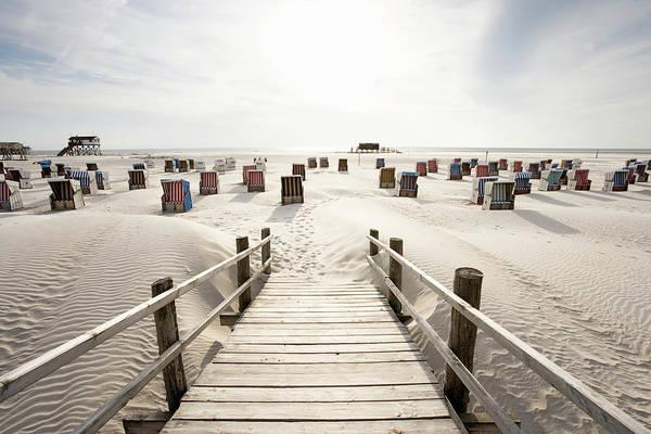 Wicker Chair Photograph - Wicker Chairs On Beach by Jorg Greuel