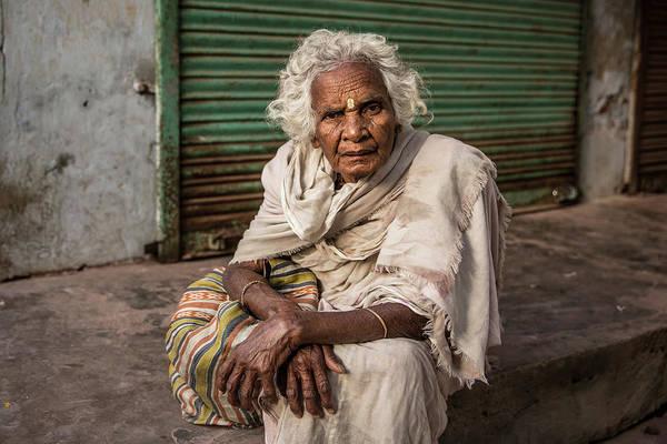 Wall Art - Photograph - Widow Sitting On The Sidewalk Of A Street In Vrindavan by Ruben Vicente