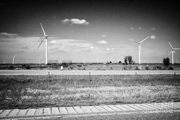 Wall Art - Photograph - wind turbines near the i-65 highway indiana USA by Joe Fox