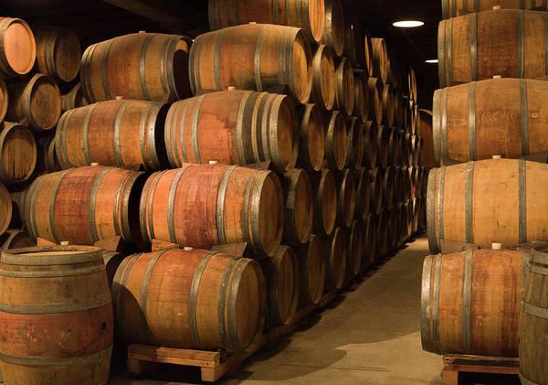 Napa Valley Photograph - Wine Barrels In Winery Cellar Of Napa by Yinyang