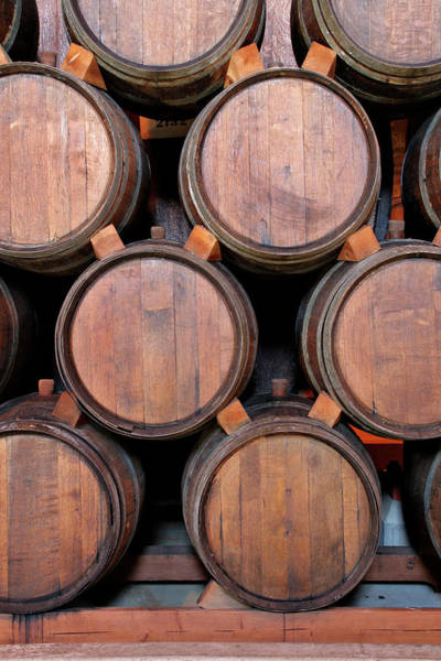 Photograph - Wine Barrels Stacked Inside Winery by Yinyang