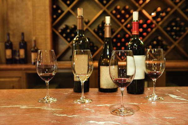 Bar Counter Photograph - Wine Bottles And Glasses by Jupiterimages