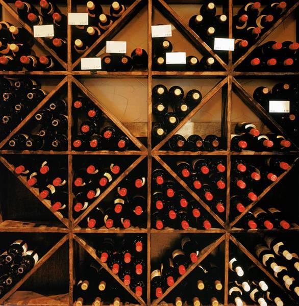 Warehouse Photograph - Wine Bottles Stored Away On Shelves by Alan Shortall