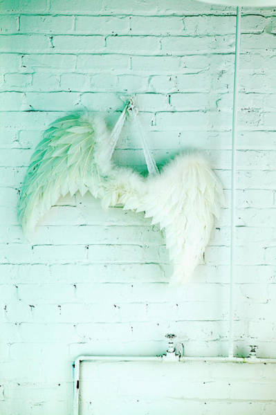 Hanging Photograph - Wings Hanging On Brick Wall by Roderick Chen