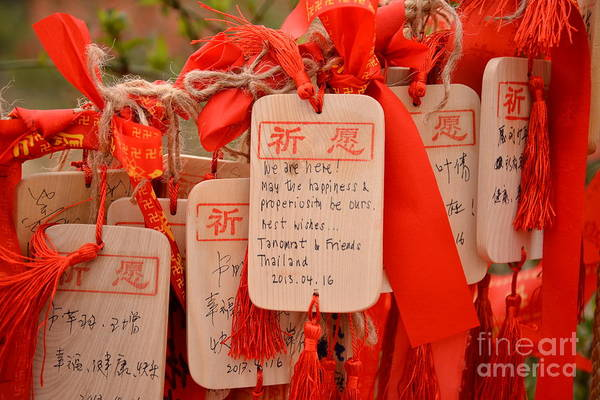 Wall Art - Photograph - Wish Cards In A Buddhist Temple In by Praphat Rattanayanon