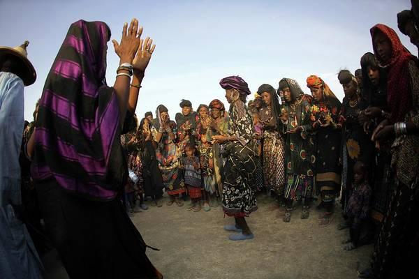 Tribal Woman Wall Art - Photograph - Wodaabe Women Dancing In A Circle by Timothy Allen