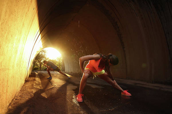 Adolescence Photograph - Woman And Man Stretching In Tunnel At by Stanislaw Pytel