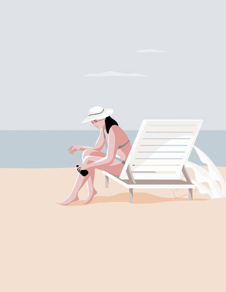 Wall Art - Photograph - Woman Applying Sun Lotion On Beach by Ikon Images