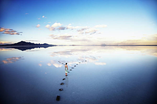Wall Art - Photograph - Woman At Fork In Stone Pathway In Lake by Thomas Barwick