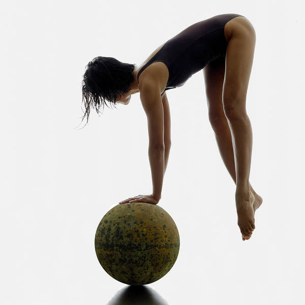 Woman Balancing On Globe Art Print by Alfonse Pagano