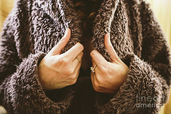 Photograph - Woman Bundling Up In A Fluffy Coat During The Cold Winter. by Joaquin Corbalan