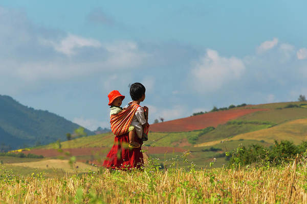Sun Hat Photograph - Woman Carrying Baby In The Mountain by Keren Su