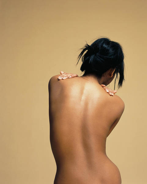Wall Art - Photograph - Woman Curving Bare Back by Toby Maudsley
