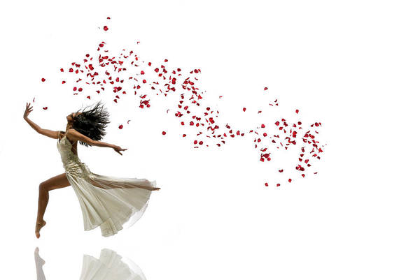 Red Dress Photograph - Woman Dancing And Jumping With Flowers by Alfonse Pagano