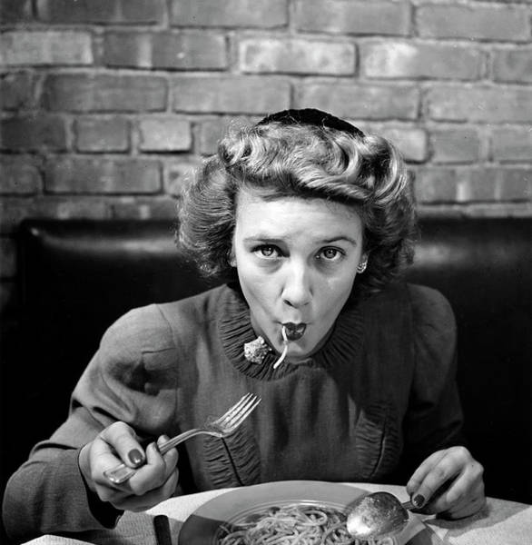 Wall Art - Photograph - Woman Eating Spaghetti In Restaurant 5 by Alfred Eisenstaedt