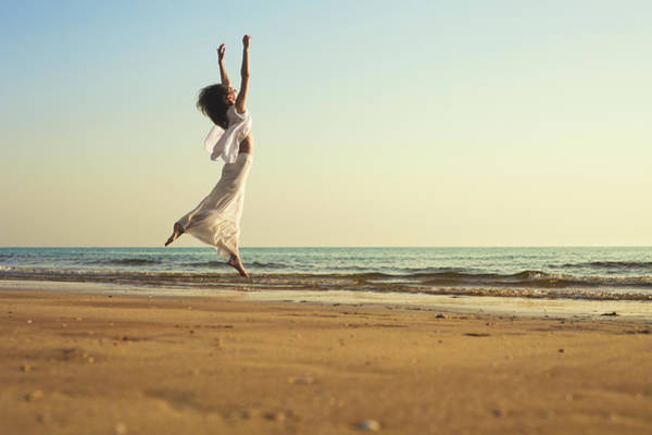 Dancing Water Photograph - Woman Enjoys The Beach At Sunset by Anneleven