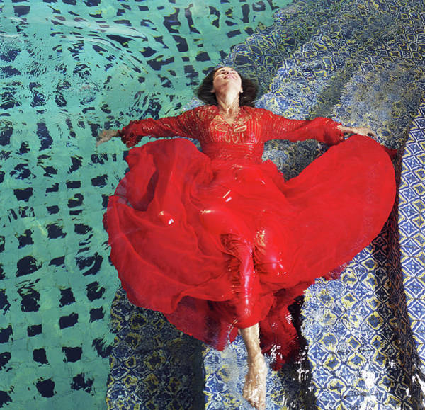 Red Dress Photograph - Woman Floating In Pool, Wearing Red by Tony Anderson