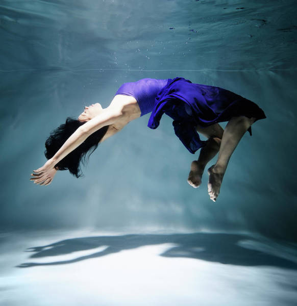Underwater Photograph - Woman Floating Underwater, Side View by Henrik Sorensen